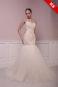 Персиковое асимметричное платье с открытой спиной.
